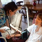 Nurse Tish Allen checks Judy Taber's blood pressure.