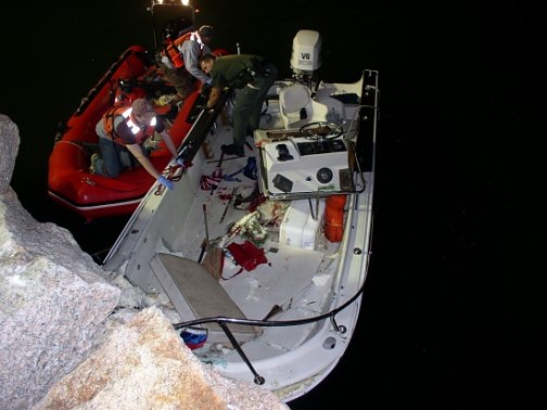 Investigators examine boat operated by Arthur K. Hall that crashed into a seawall, killing a passenger and injuring two others in 2009.