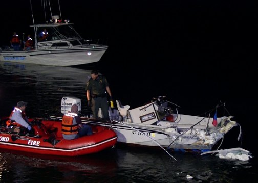 Investigators at crash site of the 2009 fatal boating accident in Long Island Sound.