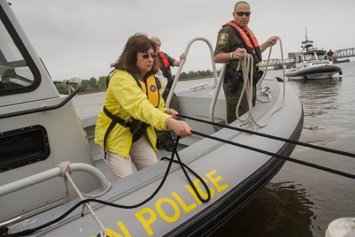 Eleanor Mariani, state boating official, secures a line during a training exercise with Conn. Environmental Conservation Police officers.