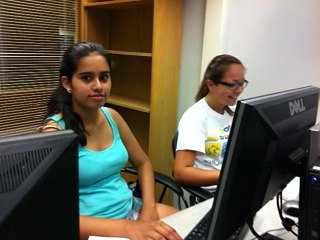 Susana and Angelica working on their story.