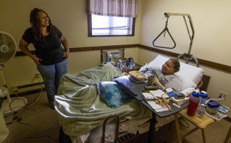 Debbie Hardy, home health care aide, with Frank Geraldino in his Seymour apartment.