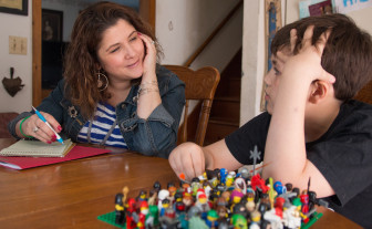 EMPS crisis clinician Heather Kunkel visits with Joey Smith, 10, at his home.