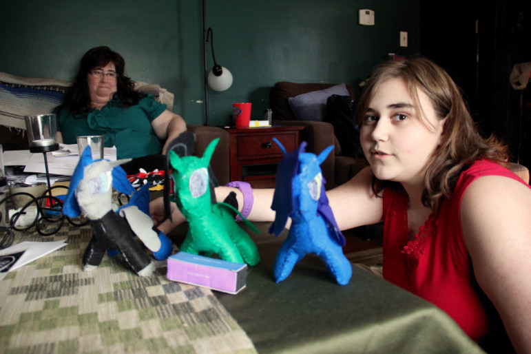 Rebekah Vincent, 12, of Wallingford, displays creatures that she created by hand, as Kimberly, her mom, looks on.