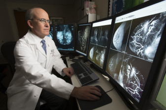 Dr. David Gruen, director of Women's Imaging at Stamford Hospital, reviews a 3-D image.