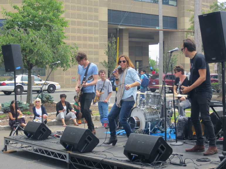 Mary McBride and her band perform outside the Conn. Mental Health Center, New Haven.