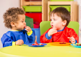 Family-based day care centers can shape a child's eating habits by offering healthy snacks, such as fruit.