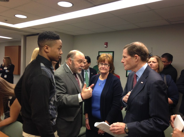 Among the participants speaking with Sen. Richard Blumenthal after the roundtable were Lance Supersad (at left), a young adult in recovery, and Karen Zaorski, whose son died of an overdose.