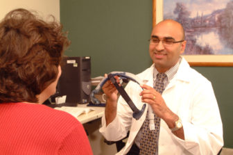 Dr. Asher Quershi encourages staff at Saint Francis Hospital to dim lights by 9 p.m.