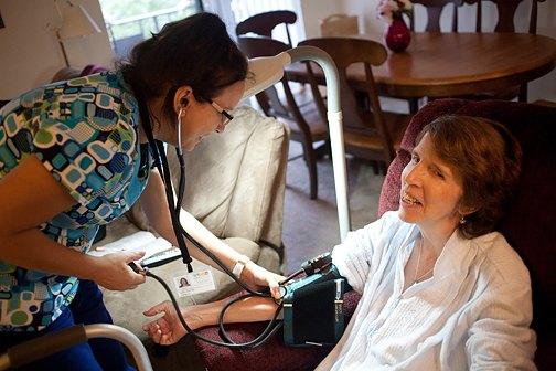 Nurse Tish Allen checks Judy Taber's blood pressure.