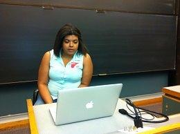 Gabrielle reading her work.