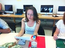 Julia reading her work in class.